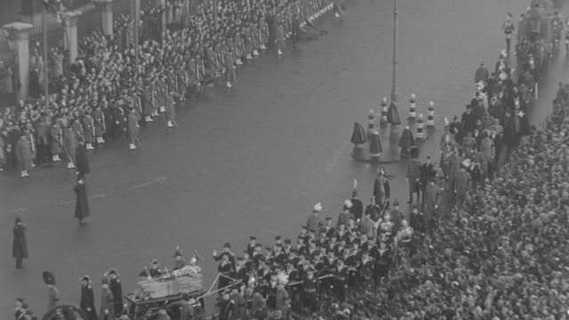 the funeral procession of king george v passes a massive crowd in london. - mourning stock videos & royalty-free footage