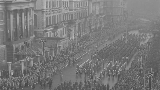 the funeral procession of king george v passes crowds of spectators in london. - british royalty stock videos & royalty-free footage