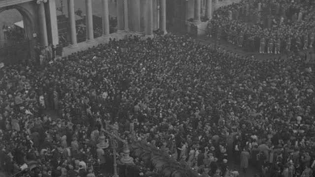 the funeral procession of king george v passes massive crowds in london. - british royalty stock videos & royalty-free footage