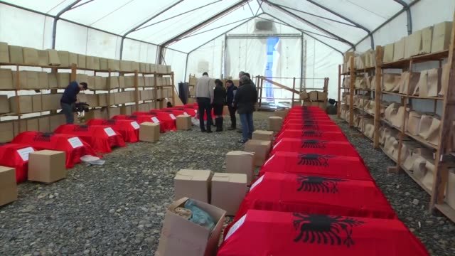 the funerals of twentyeight albanians killed during the kosovo war in 19981999 were found in rudnica in raska and handed over to their families after... - pristina stock videos and b-roll footage
