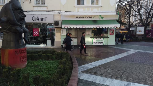 the funny symbol of haskovo is called as joke between people - kaun monument or also known as melon people are seen walking along the main pedestrian... - religious symbol stock videos & royalty-free footage