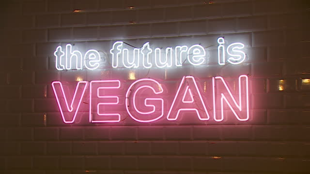 the future is vegan sign in vegan restaurant london - vegan food stock videos & royalty-free footage