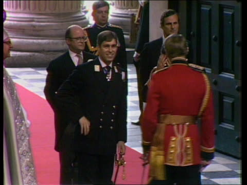 the future royal engagement the future itv ob ms prince andrew showing prince charles he has wedding ring as stand waiting before wedding itn lib... - ヨーク公 アンドルー王子点の映像素材/bロール