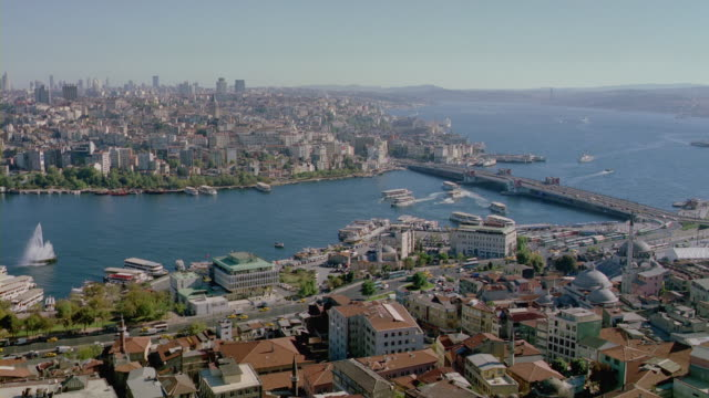 the galata bridge spans the golden horn harbor in istanbul. - golden horn istanbul stock videos and b-roll footage