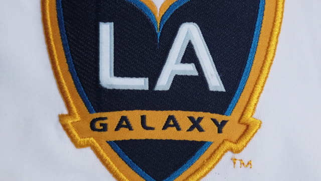 the galaxy club crest on their home shirt on may 27, 2020 in manchester, england. - southern california stock videos & royalty-free footage