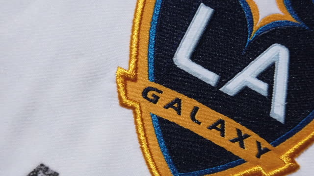 the la galaxy club crest on their home shirt on may 28 2020 in manchester england - all shirts stock videos & royalty-free footage