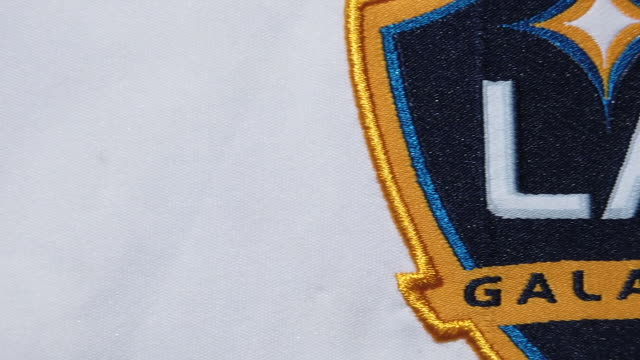 the galaxy club crest on their home shirt on may 28, 2020 in manchester, england. - southern california stock videos & royalty-free footage