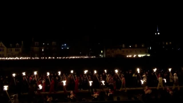 the galley is set on fire on shetland isles during the up helly aa viking festival originating in the 1880s the festival celebrates shetland's norse... - galeere stock-videos und b-roll-filmmaterial