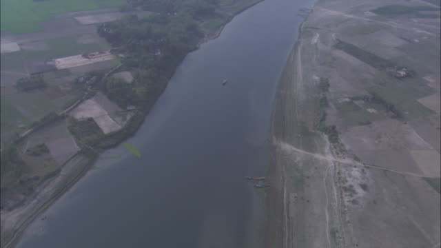 the ganges river stretches between farmlands in bangladesh. available in hd. - bangladeshi culture stock videos & royalty-free footage