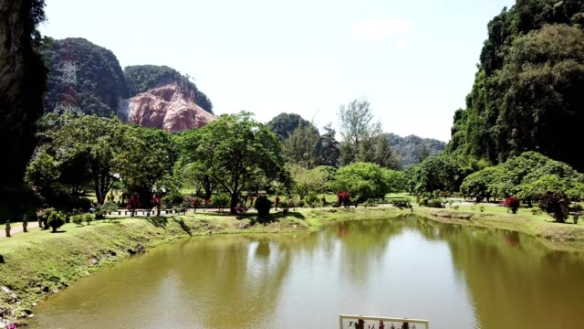 The garden and pond outside of the Kek Lok Tong cave temple in Ipoh, Perak, Malaysia