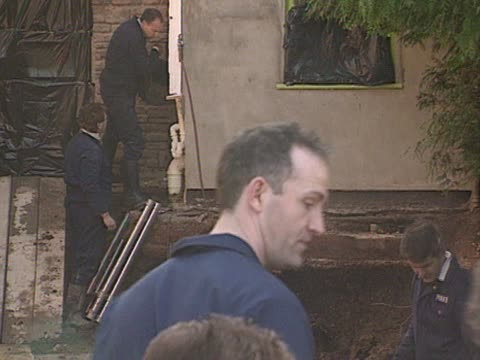 The garden of 25 Cromwell Street is excavated in the search for the bodies of the women murdered by Fred and Rose West