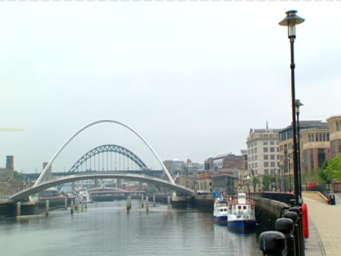 the gateshead millennium bridge arches over the river tyne in gateshead-newcastle, england. - tyne and wear stock videos & royalty-free footage