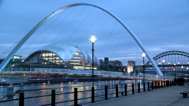 the gateshead millennium bridge illuminated in dusk, newcastle upon tyne - newcastle upon tyne stock videos and b-roll footage