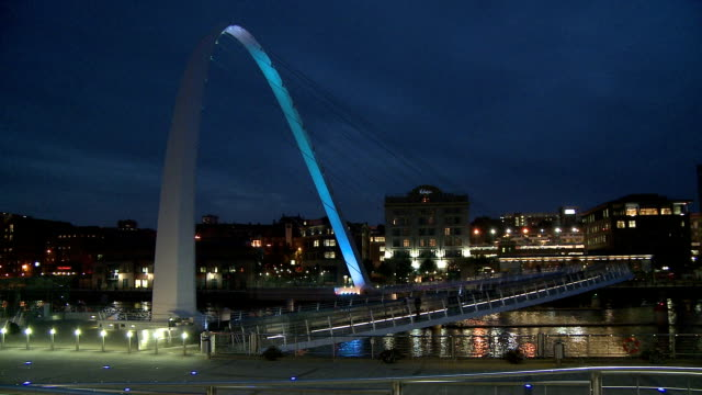 the gateshead millennium bridge illuminated in dusk, newcastle upon tyne - newcastle upon tyne stock videos and b-roll footage