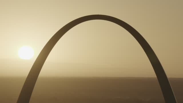 the gateway arch backlit by sunrise - arch architectural feature stock videos and b-roll footage