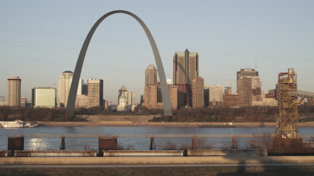 The Gateway Arch rises above skyscrapers in St. Louis.