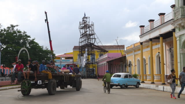 the general ambiance of the jose marti park which is the main square or plaza in the colonial village a russian tractor passes with parts of the... - general electric building stock videos and b-roll footage