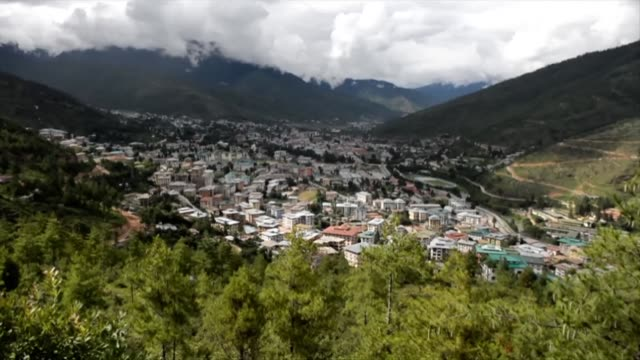 vídeos y material grabado en eventos de stock de the gentle whirring of the windmill spoke of bhutan's giant stride as the only carbon negative country in the world - paso largo