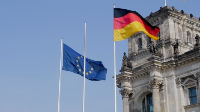 the german national flag flying in the wind together with the eu flag - berlin stock videos & royalty-free footage