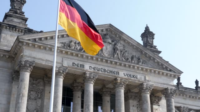 the german national flag flying in the wind together with the eu flag at the reichstag building - 欧州連合旗点の映像素材/bロール