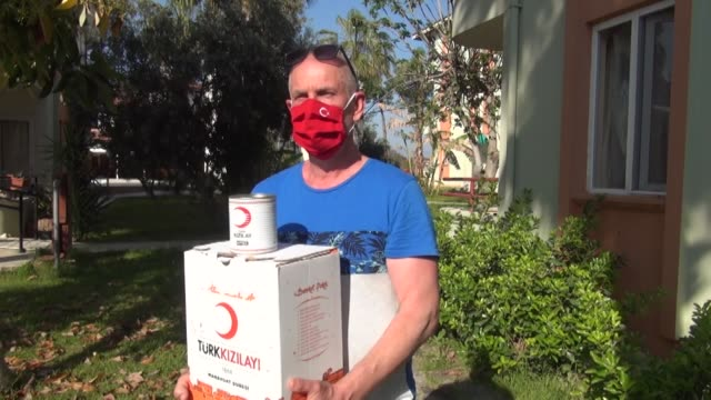the germans living in antalya's manavgat district as resident aliens receive help by turkish red crescent and vefa social support group on april 15,... - 60 64 years stock videos & royalty-free footage
