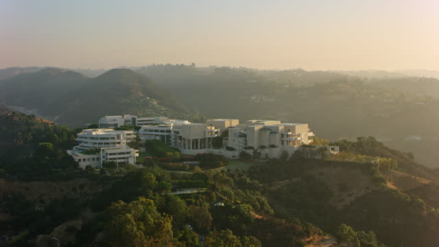 aerial the getty center in brentwood, los angeles in the morning sun - brentwood los angeles stock videos & royalty-free footage