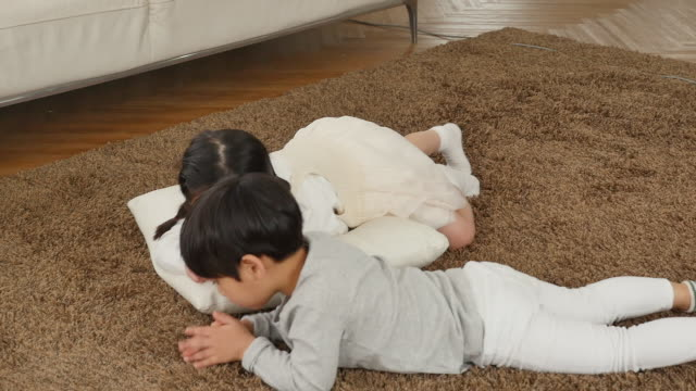 the girl and boy sit and play on the carpet - pigtails stock videos & royalty-free footage