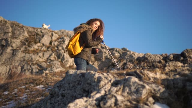 the girl climber at the top of the mountain. - high up stock videos & royalty-free footage