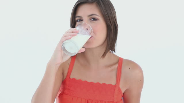 girl drink a glass of milk - one young woman only stock videos & royalty-free footage
