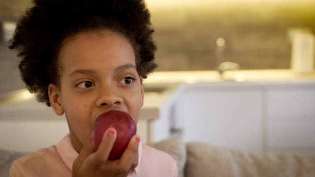 the girl eats an apple - apple fruit stock videos & royalty-free footage