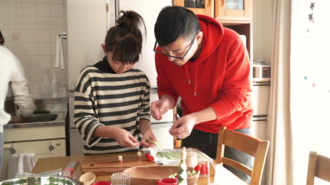 the girl helping cooking - preparing food stock videos & royalty-free footage