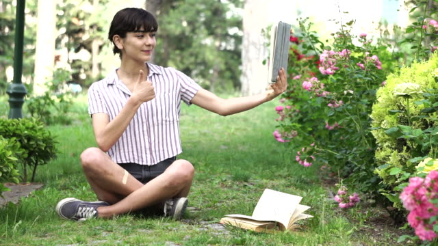 the girl is studying in the garden - seat stock videos & royalty-free footage