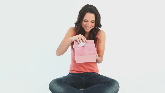 girl opens her gift - brown hair stock videos & royalty-free footage
