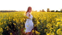 The girl runs on the flower field
