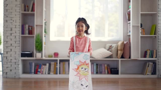 the girl smiles holding a drawing paper - korea stock videos & royalty-free footage