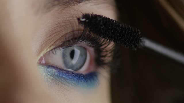 the girl uses mascara. fashion video. slow motion. 4k 30fps prores 4444 - make up stock videos & royalty-free footage