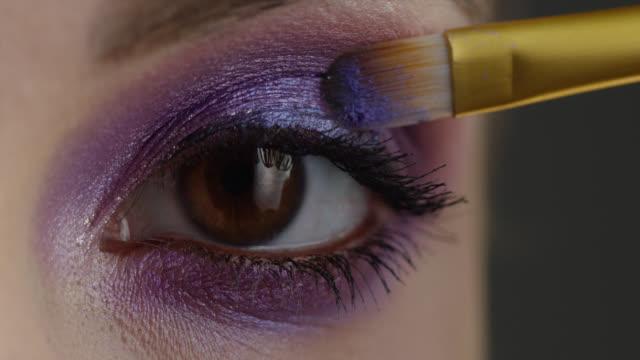 the girl uses mascara. fashion video. slow motion. - eyeshadow stock videos & royalty-free footage