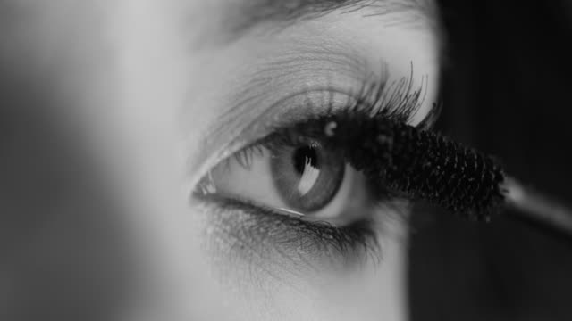 the girl uses mascara. fashion video. slow motion. - femininity stock videos & royalty-free footage