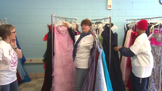 the glass slipper project partnered with us again textile company to give away prom dresses to 600 high school girls. - ホームカミング点の映像素材/bロール