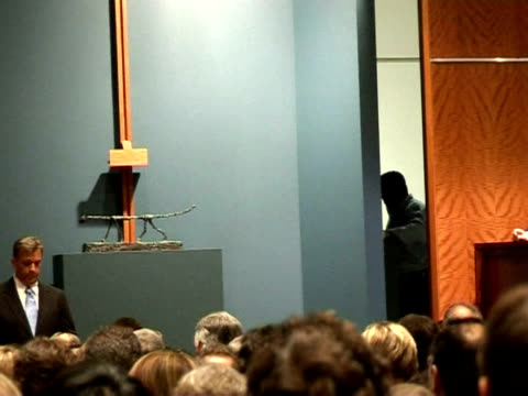 the global financial crisis has put a damper on the highflying art auction world with big names going unsold at the begining of the spring auction... - sotheby's stock videos and b-roll footage