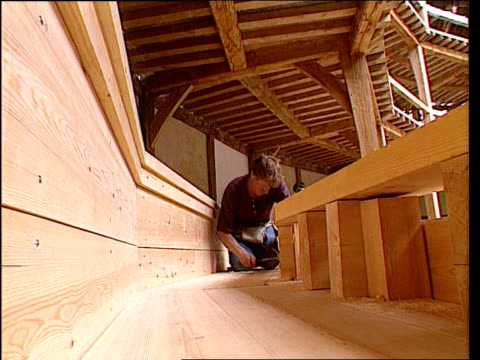the globe theatre special itn england london south bank cs drawing of elizabethan london pan rl cs the globe on the drawing la lms man sawing wood... - thatched roof stock videos and b-roll footage