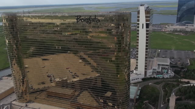 the glossy exteriors of the borgata and water club casinos reflect adjacent buildings in atlantic city. - atlantic city stock videos & royalty-free footage