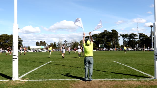 the goal umpire signals a goal during the mid gippsland football league grand finals at morwell recreation reserve on september 8 2018 in morwell... - referee stock videos & royalty-free footage