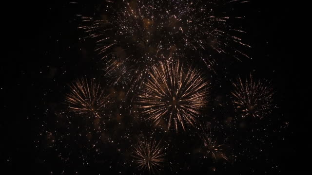 the gold star dust firework is glowing and fade to dark bangkok,thailand - fade out video transition stock videos & royalty-free footage
