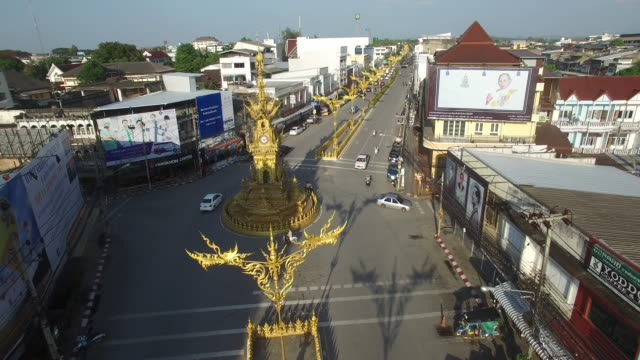 the golden clocktower sitting in the middle of a roundabout on baanpa pragarn road in central chiang rai - chiang rai province stock videos and b-roll footage