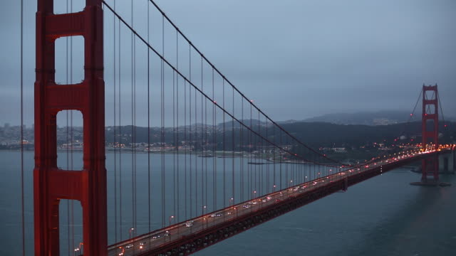 the golden gate bridge at night from the marin headlands with the city of san francisco behind it. - nordkalifornien stock-videos und b-roll-filmmaterial