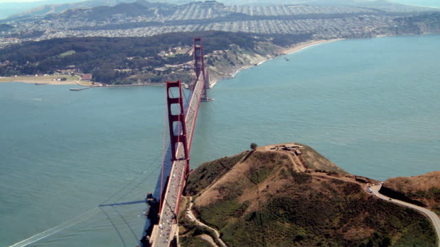 the golden gate bridge extends over san francisco bay. - san francisco bay stock videos & royalty-free footage
