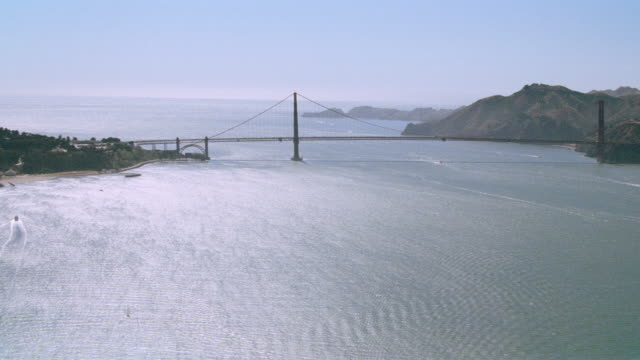 the golden gate bridge extends over san francisco bay. - golden gate bridge stock videos & royalty-free footage