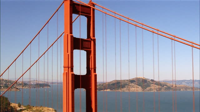 the golden gate bridge spans san francisco bay. - san francisco bay stock videos & royalty-free footage