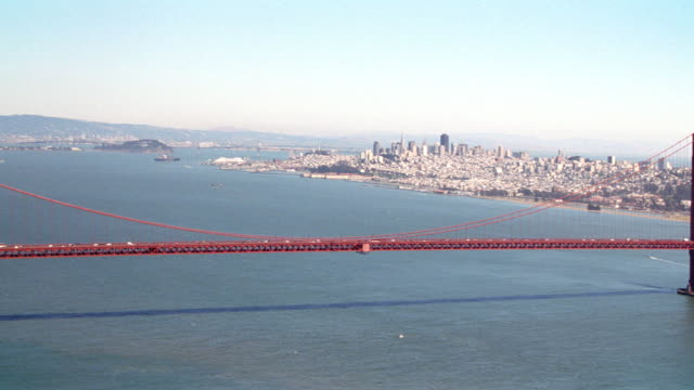 the golden gate bridge spans the san francisco bay. - san francisco bay stock videos & royalty-free footage